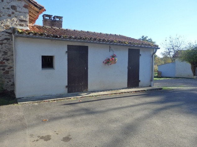 Traditional Hamlet House with Attached Garden, 2 Garages and Extra Land with Pond 10738